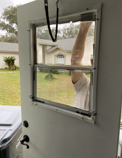 The process of a new window being installed on a door