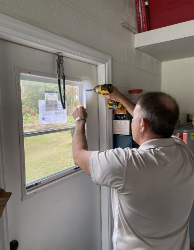 Drilling in a much needed new window on a door in Lakeland