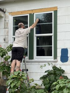 Window replacement specialist putting final touches on new window for Florida home
