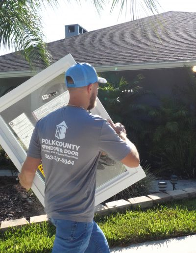 Window installer heading up to a home in Winter Haven